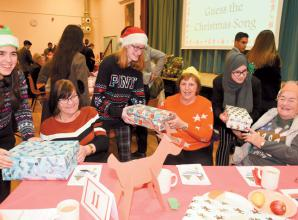 Guests enjoy entertainment at annual Burnham Senior's Community Christmas Party