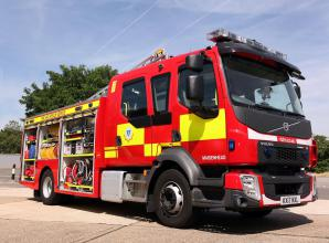 Firefighters tackling fire at commercial premises in Bath Road