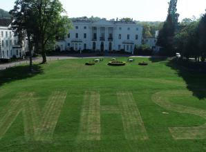 Old Windsor Estate pays tribute to workers by hand cutting 'NHS' into front lawn