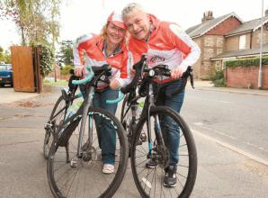 Burnham couple complete bike ride for late friend Ruth Strauss
