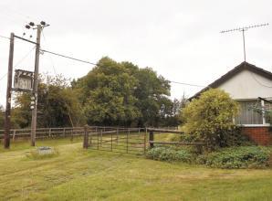 Landowner battles transformer on his property