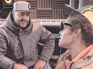 Slough's striving street singer gets first studio break