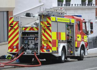Firefighter issues smoke alarm warning following Burnham flat fire