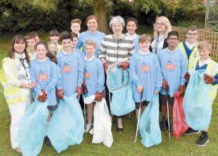 Theresa May helps out St Mary's pupils on litter pick