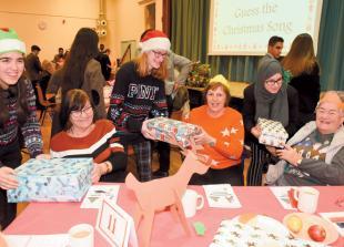 Guests enjoy entertainment at annual Burnham Senior's Community Christmas Party