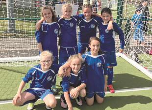 Undefeated Maidenhead B&G FC u11s girls lift Marlow Tournament trophy