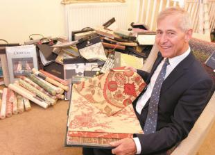 Furnishing business giving away fabric books ahead of relocation