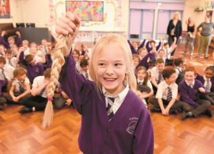 In pictures: Burnham pupil clips long locks for The Princess Trust