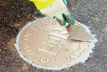 Gunmetal markers line The Queen's Walkway route around Windsor